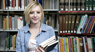 Image of female student with books in her hand