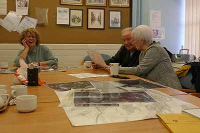 A community group exploring materials from the University's archives