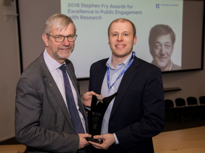 Prof Sir Pete Downes, Principal and Vice-Chancellor presents the 2018 Stephen Fry Award for Engaged Researcher of the Year to Dr Daniel Cook (right).