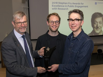 Professor Sir Pete Downes (Left), Principal and Vice-Chancellor, presents the 2018 Stephen Fry Engagement Project of the Year award to Hands of X team members Andrew Cook (centre) and Dr Graham Pullin (right).