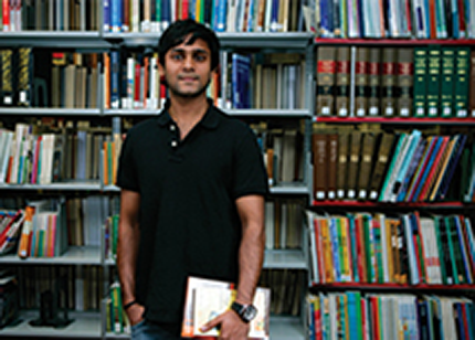 Image of student in the library