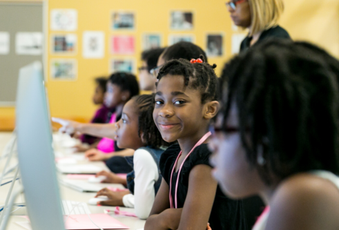 black girls at computers learning to code